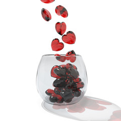 red hearts falling into a glass