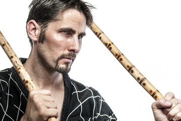 Martial arts master with bamboo sticks
