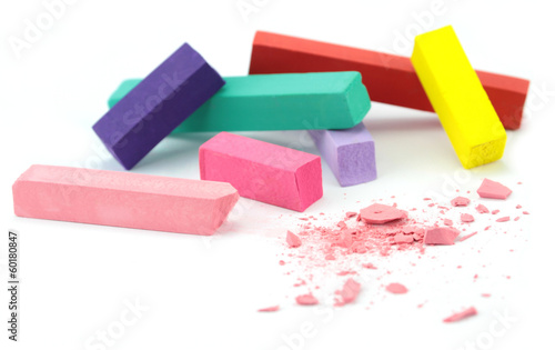 Colorful chalks on white background.