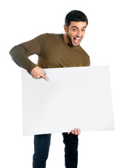 Attractive man showing and pointing blank billboard