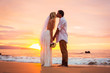 Married couple, bride and groom, kissing at sunset on beautiful - 60184839