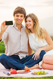 Couple Taking Selfie With Mobile Phone poster