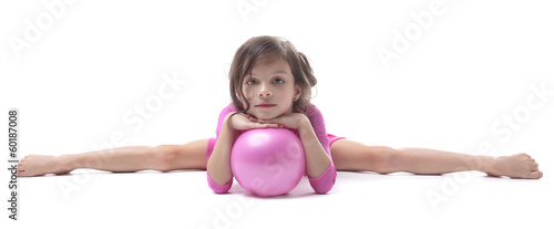 Image of adorable little gymnast doing split
