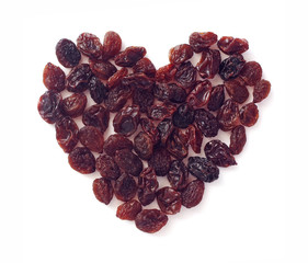 heart shape from raisins on white background
