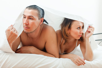 Unhappy man and woman having  problem in bed