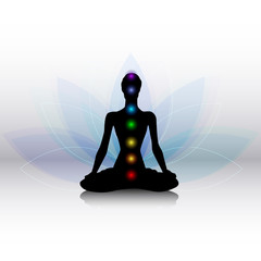 Yoga silhouette with chakras