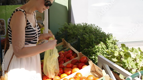 Young woman shopping for fresh vegetables