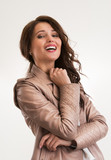 Beautiful brunette woman laughing and looking at camera