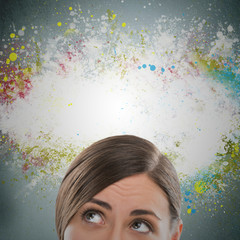 Colorful Thinking. Woman against gray background and colorful sp
