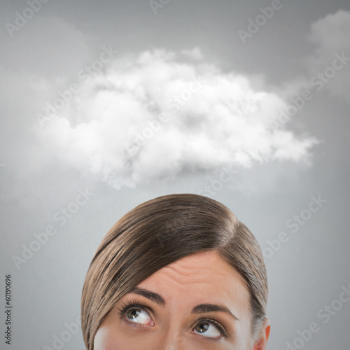 Close up of young woman looking up for thought bubble above her