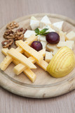 Cheese platter with walnuts and selective focus