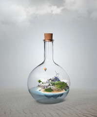 Corked glass bottle with beautiful island and sea inside. Confid