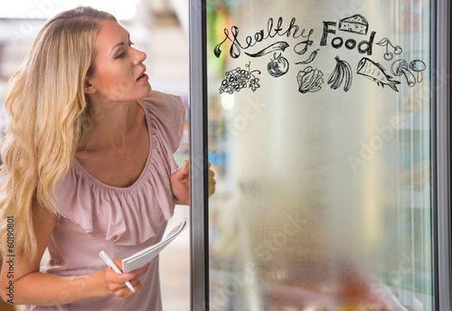 Young pretty woman thinking of healthy food while shopping at gr