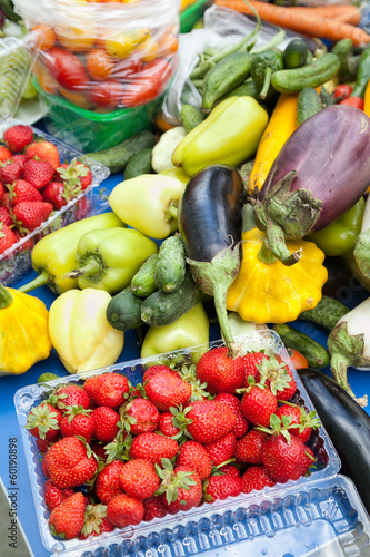 Strawberries with bunch of vegetables on table