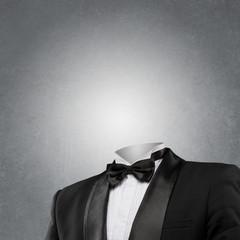 Man without head on dark concrete background