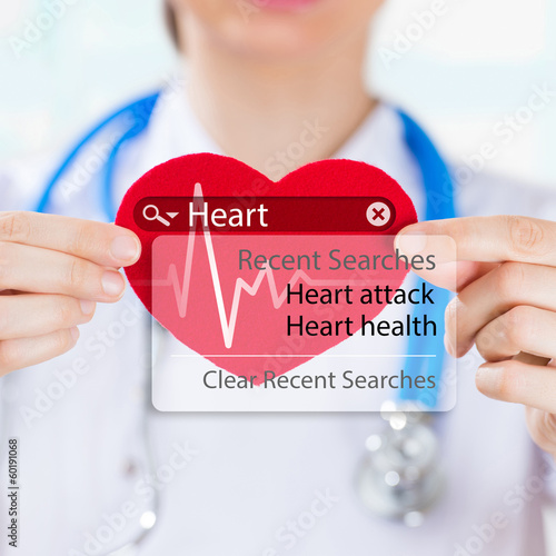 Doctor holding heart and heartbeat symbol with search engine and