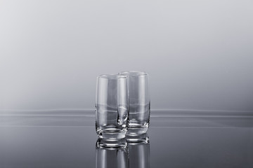 Two transparent empty tall glasses
