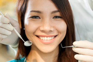 Portrait of beautiful asian woman sitting at the dentist