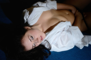 The girl on the bed take a masturbation