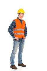 Construction worker in yellow helmet and orange waistcoat.