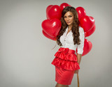 Portrait of beautiful woman with red balloon heart