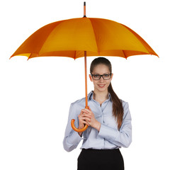 Happy woman standing under a large umbrella