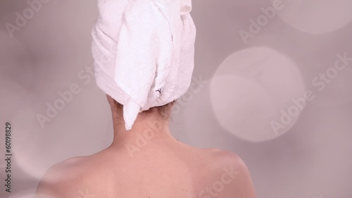 Beautiful woman enjoying spa treatment sparkling effect