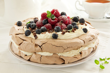 "Chocolate Cake ""Pavlova"" with raspberries and blueberries."