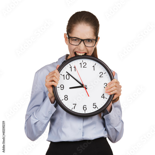 Girl in a state of stress bites the clock