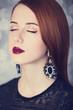 Beautiful redhead women with earrings.