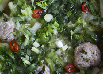 Thai noodle soup with meatballs, Chinese cabbage and cilantro