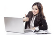 Leinwanddruck Bild - smiling  business woman at desk with laptop showing thumbs up