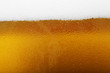 Close-up picture of a beer with foam and bubbles - 60205287