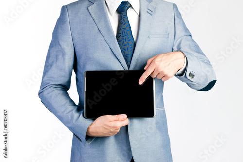 Businessman presenting tablet computer