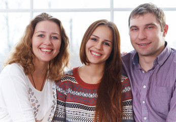 Smiling happy family with teenage daughter