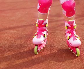 Rollerblades / inline skates of a child closeup in action outdoo
