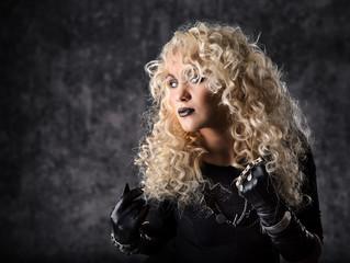 Woman blonde curly hair, beauty portrait in black