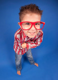 Cheerful funny five years old boy wearing glasses
