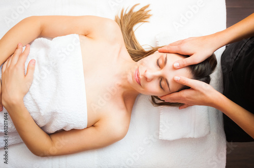 Woman having an head massage