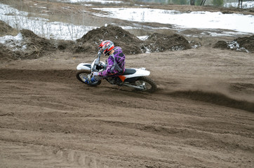 MX rider veering point-blank of sand with