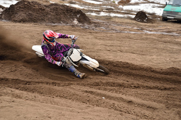 MX racing driver at the turning in the sandy ruts