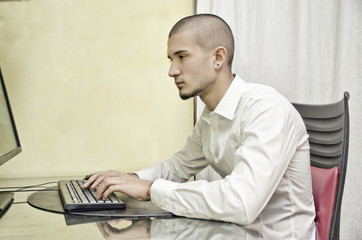 Young man working from home at computer