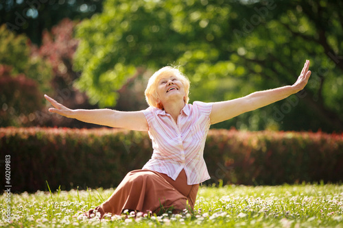 Meditation. Mature Pleased Woman Relaxing with Outspread Arms