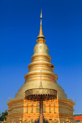 Golden Pagoda at Wat Phra That Hariphunchai in Thailand.