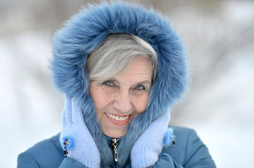 Old woman in the winter