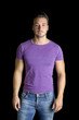 Handsome friendly young man standing in t-shirt and jeans
