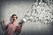 man yells into a megaphone