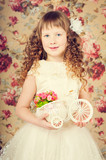 Vintage little girl portarait with long curly hair