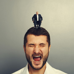 shocked man with small happy boss