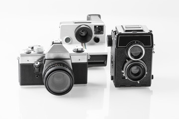 Three vintage analogue cameras